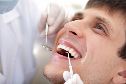 man-at-dentist